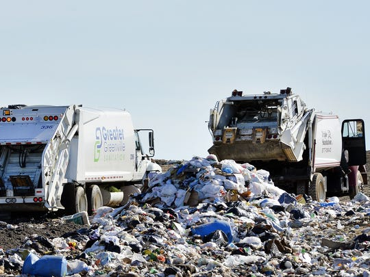 Thousands of seagulls pick for food as trucks dump waste into Greenville County's Twin Chimneys Landfill.