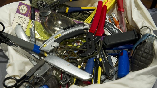 Knives, scissors and other banned items pulled at security checkpoints.