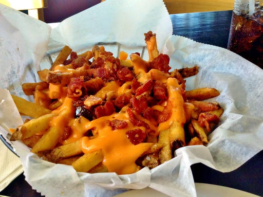 Chicago Poutine, hand-cut fries with Merkt's cheddar cheese and house-cured cayenne candied bacon at Henning's Chicago Kitchen in Naples.