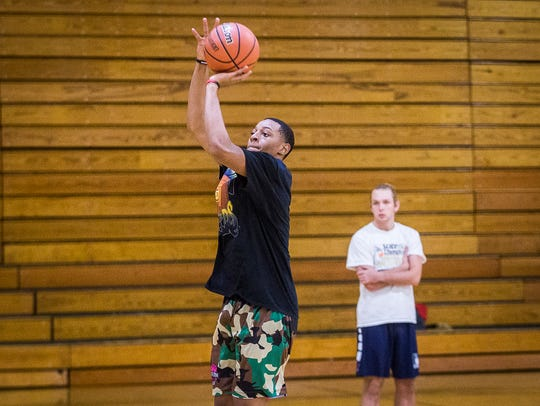 Central basketball players run through drills during