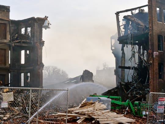 The remnants of the old Weaver Organ and Piano building are pictured Thursday, the day after a fire destroyed much of the building in York. Two firefighters died and two others are being treated after part of the building collapsed Thursday. York mayor Michael Helfrich said the four firefighters were all York City Fire firefighters.