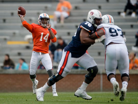 Auburn quarterback Malik Willis (14) throws a pass