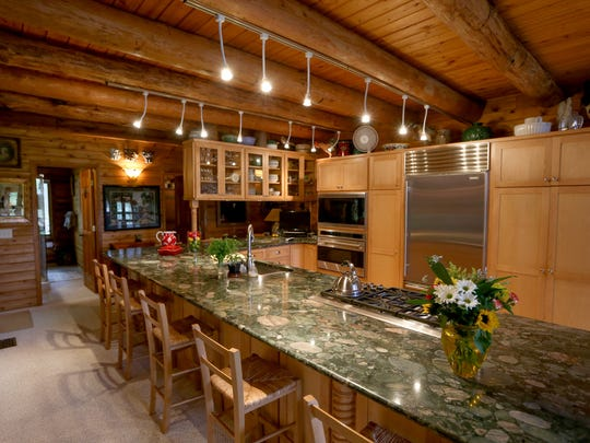 Current owners created a U-shaped kitchen with light