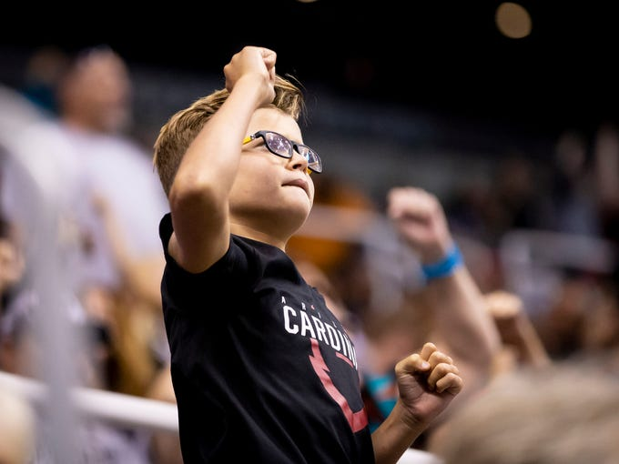 A young fan cheers during the playoff game between
