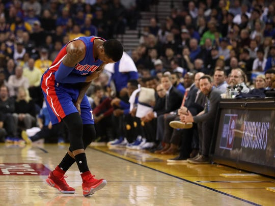 Pistons guard Kentavious Caldwell-Pope holds his left shoulder in the first quarter against the Warriors at ORACLE Arena on Jan. 12, 2017 in Oakland, Calif.