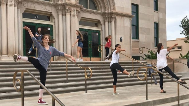 Ballet San Angelo students practice for Sharing Dance Day on the steps of City Hall