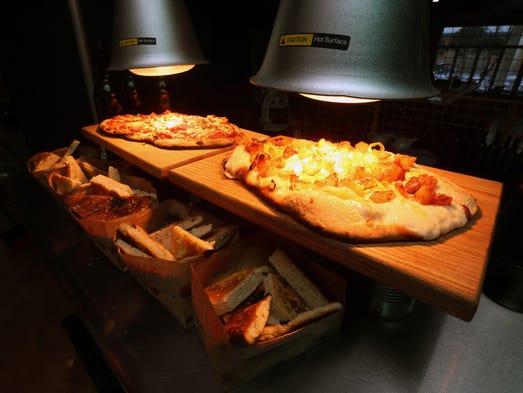 Fresh baked focaccia, bottom, and a potato leek pizza