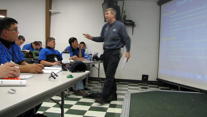 Larry Wostenberg teaches an engine management systems class at the WyoTech technical school campus in Laramie, Wyo., owned by Corinthian Colleges Inc.