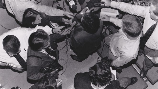Rudi Keller, bottom center right, takes part in a press scrum with State Auditor Margaret Kelly during the 1996 campaign for governor. Kelly, a Republican, lost to Democratic incumbent Gov. Mel Carnahan.