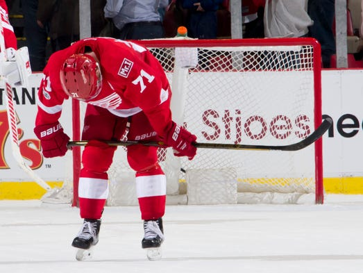 Detroit center Dylan Larkin hangs his head after St.