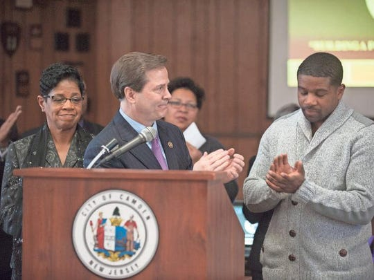 Pastor Dana Green and her son Anwar Green look on as Congressman Donald Norcross speaks during a press conference to announce a New Jersey Department of Labor & Workforce Development program aimed at training Camden residents. The program will be named after Pastor Green's late husband Ronald Green. Tuesday, February 17, 2015.