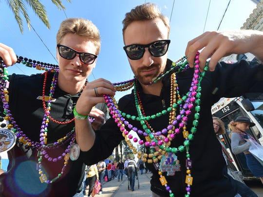 IndyCar drivers Josef Newgarden and James Hinchcliffe show their beads for Mardi Gras.