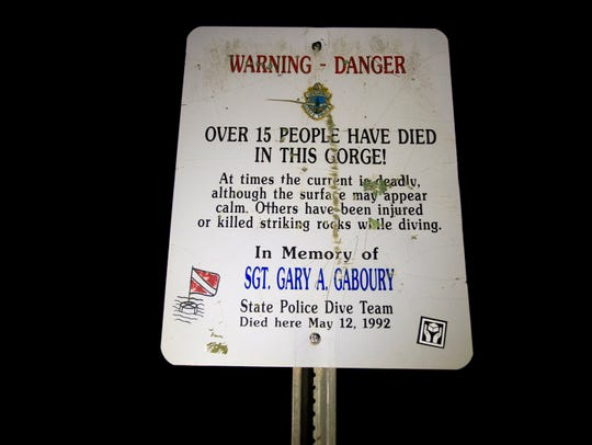 A sign posted at the Huntington Gorge in Richmond warns
