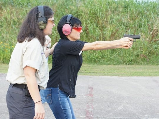 Adrianna Eschete (left) provides firearms tips and