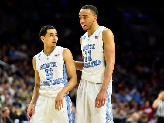 Mar 25, 2016; Philadelphia, PA, USA; North Carolina Tar Heels guard Marcus Paige (5) talks with forward Brice Johnson (11) during the second half against the Indiana Hoosiers in a semifinal game in the East regional of the NCAA Tournament at Wells Fargo Center.