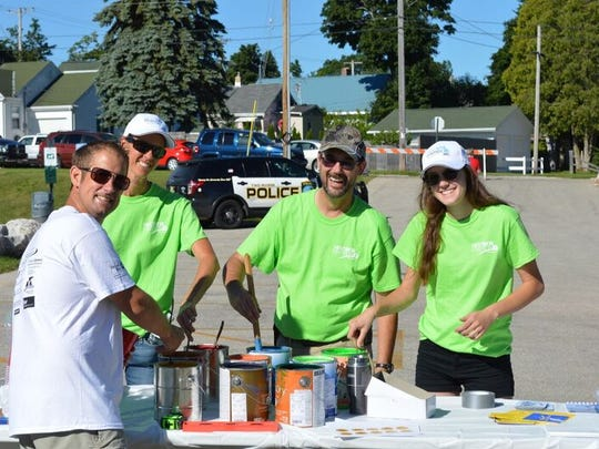 Volunteers paint during United Way Manitowoc County's Day of Action Saturday at Washington Park in Two Rivers.