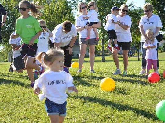 Children play with brightly colored balls during the annual Day of Action for the United Way Manitowoc County Saturday.