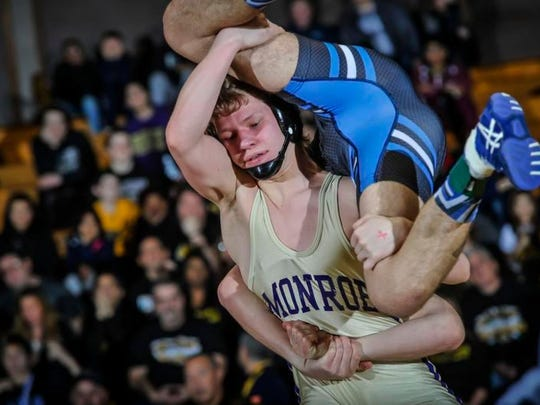 Monroe's Nick Lombard (left) lifts Middlesex's Jeff Johnson during their 145- pound final match at the GMC Tournament on Saturday at Piscataway High School.