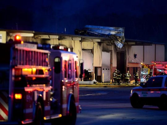 Firefighters work the scene at Sealing Agents, a waterproofing business, Nov. 15 on Mills Gap Road in Fletcher.
