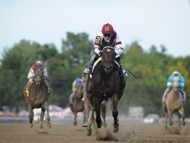 """Champion Royal Delta, with Mike Smith riding, takes over on the backstretch and cruises to a commanding 4 1/2-length victory in the 66th running of the Grade 1, $600,000 Personal Ensign Invitational Handicap at Saratoga on Aug. 25. The victory earned the 5-year-old mare, a two-time Eclipse Award winner, an automatic berth and an all-fees-paid entry into the Breeders' Cup Distaff at Santa Anita this fall as part of the Breeders' Cup Challenge """"Win and You're In"""" series. The odds-on favorite finished the 1 1/8 miles in 1:48.34."""