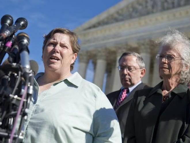 Linda Stephens, right, an atheist, speaks to the media Wednesday alongside co-plaintiff Susan Galloway, who is Jewish, following oral arguments in the case of Town of Greece v. Galloway outside the U.S. Supreme Court in Washington, D.C.