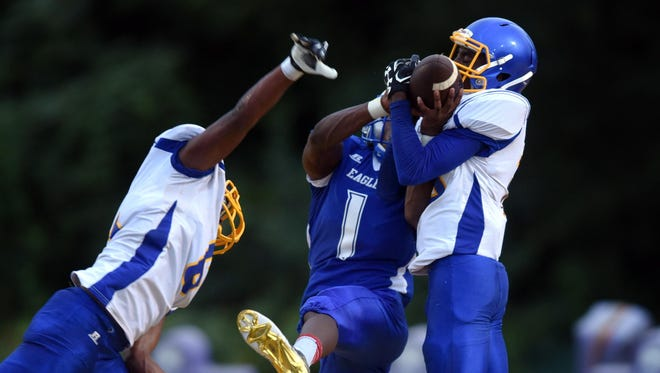 Columbia's Taveoungh Brown, right, intercepts the ball from North Forrest's Christian Williamson during a jamboree game on Friday at Hattiesburg High School.