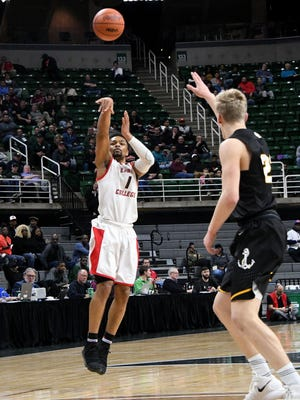 Detroit Edison's Pierre Mitchell shoots a three-pointer during the second quarter.