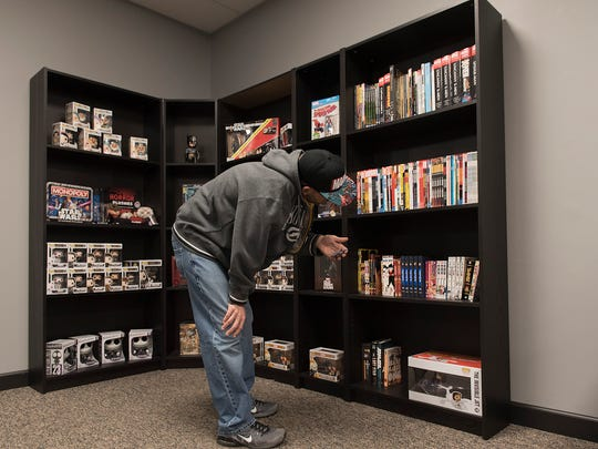 Josh Blanton browses the shelves. He works at the new store.
