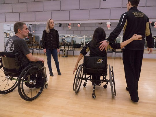 Instructors Tamerlan Gadirov and Cheryl Angelelli show Laney and Tom Hoatlin learn how to refine their dance.