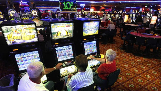 Gamblers at the Royal River Casino. A federal judge ruled the tribe does not have to collect use taxes on non-tribal members on gambling related activities.