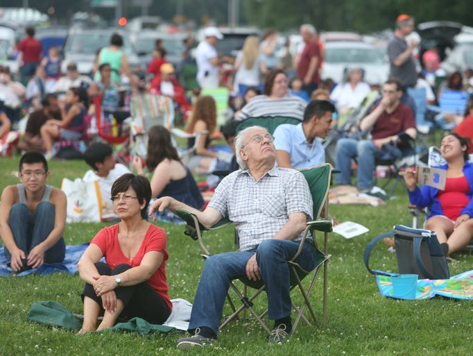 People enjoy the festivities on the lawn at the Kensico dam plaza in Valhalla as they get ready for the annual Westchester County fireworks show July 3, 2014.