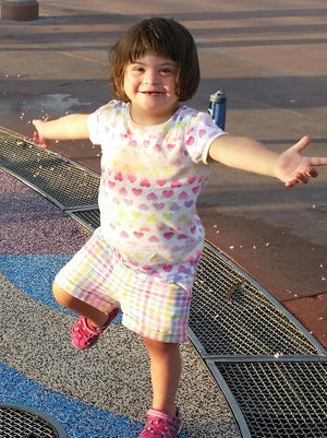 "Michaela Eddy is ready for some fun at the water feature in de Luna park. Michaela is one of many children and adults who benefit from the services at Capstone Adaptive Learning Centers. Capstone will holds its annual ""Wine a Little, Dine a Lot"" fundraiser on Aug. 5, 2017, to help support its programs."