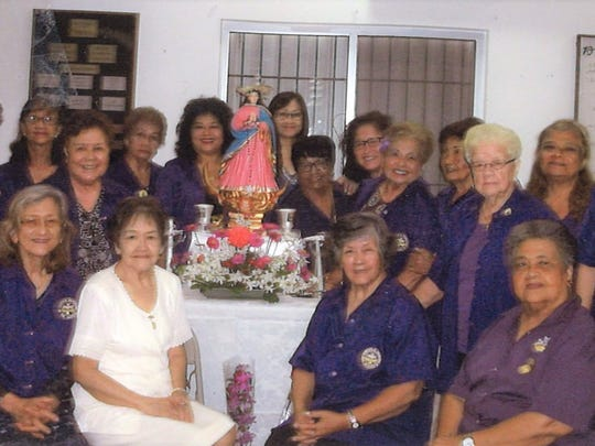Members of the Catholic Daughters of the Americas, Court Our Lady of Camarin #2047 following the May Crowing of the Blessed Mother by Maria Macias (in white) held May 2 in Hagatna. Pictured seated from left: Connie Cruz, Maria Macias, Liz Untalan, Maria Limtiaco. Standing from left: Mary Torres, Priscilla Muna, Julia Viloria, Ann Galvez, Ann Chargualaf, Marian Aflague, Jennifer Paulino, Terry Alegarbes, Evelyn Rodriguez, Rosita Diaz, Rita Okiyama, Amparo Garcia, LouJean Borja and MaryLou Agustin.
