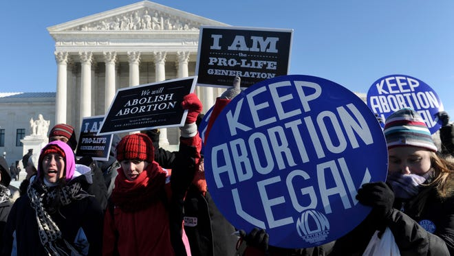 Protesters on either side of the abortion issue rally outside the Supreme Court in Washington last year.