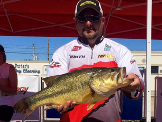 Kelly Keith wins big bass honors and $500 for a 9.08-pound lunker caught in the H&W Marine event Saturday.