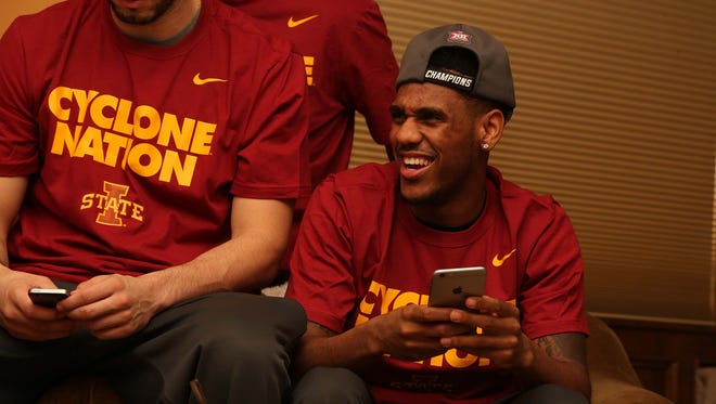 Iowa State men's basketball player Monte Morris on his phone after finding out when and where the team will play in the NCAA tournament on Sunday, March 15, 2015 in head coach Fred Hoiberg's home in Ames.