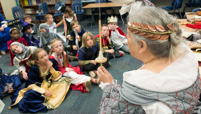 Medieval demonstrator, Phyllis Desmoines, gives a lecture on textiles and garment making to a group of third-graders at Gulf Breeze Elementary School Friday morning May 6, 2016. Santa Rosa County School District third-grade students ranked second among 67 districts in the state in percentage who achieved level 3 or above on Florida Standards Assessment English Language Arts test.