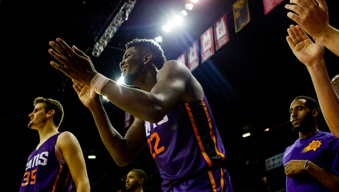 Deandre Ayton (22) celebrates a basket on during the Suns' summer-league game on Saturday.
