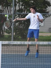 Mountain Home's Jake McGehee returns a shot during