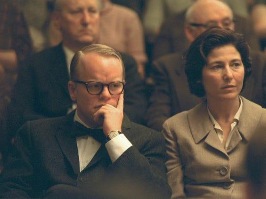 """At left, Philip Seymour Hoffman as Truman Capote in """"Capote."""""""