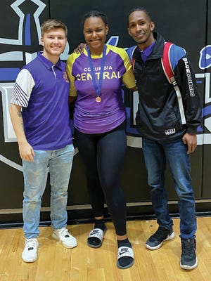 Trinity Robinson (center, with coaches Payton Sisk and Dane Peoples) is the first Columbia Central wrestler in the program's three-year history to qualify for the state tournament, following her third-place finish at the West Region tournament at Nolensville earlier this month.