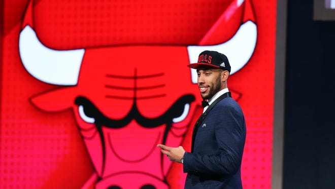Former MSU and Sexton High star Denzel Valentine  walks off stage after being selected by the Chicago Bulls with the No. 14 pick of the NBA Draft on Thursday in Brooklyn, New York.