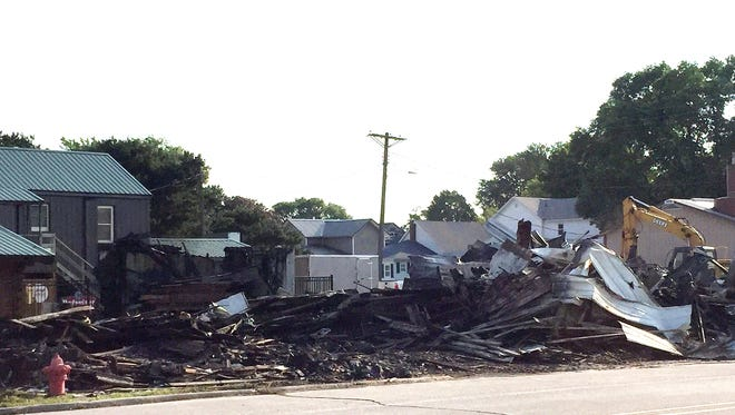 This was the scene Monday, June 12, where a fire had occured the night before on Van Horne's Main Street. The building was excavated to get to the fire in the wood between tin walls of the storage building, owned by William F. Willis of California.