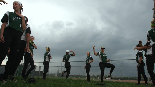 Before the storm clouds rolled in, Mason's softball team danced before a game at Lakota East on April 20, 2017.