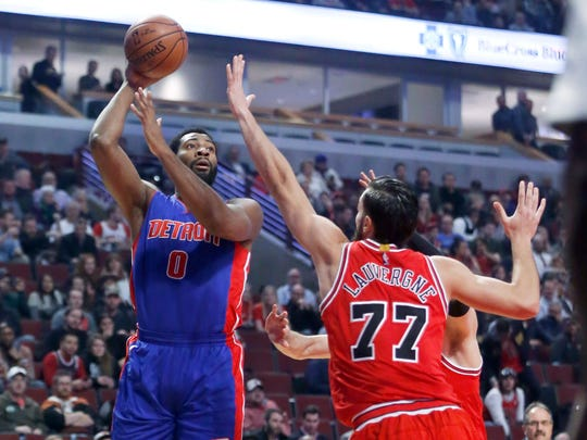 Andre Drummond shoots a hook shot over the Bulls' Joffrey Lauvergne on March 22, 2017 in Chicago.