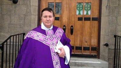 (File photo) The Rev. Richard Gill outside the Roman Catholic Church of St. Lawrence O'Toole.