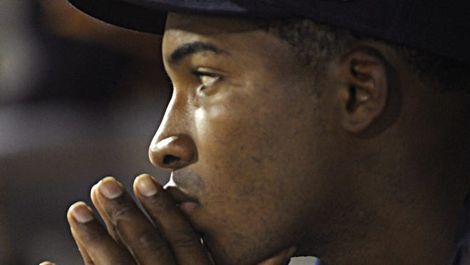 Montgomery Biscuits pitcher Frank De Los Santos reflects in the dugout after giving up a two-run homer in the eighth inning. Montgomery Biscuits pitcher Frank De Los Santos reflects in the dugout after giving up a  two-run homer in the eighth inning against the Blue Wahoos.