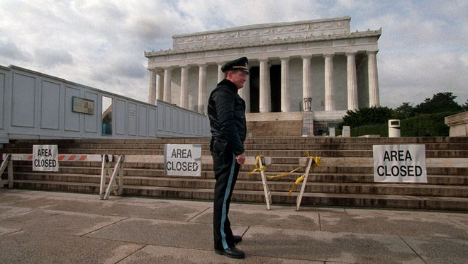 U.S. Park Service Police Officer P.G. Carroll stands in front of closed signs at the Lincoln Memorial on Nov. 15, 1995, in Washington during a partial shutdown of the federal government. There have been 17 government shutdowns since 1976, ranging in length from one to 21 days.