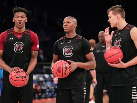 From left, South Carolina forward Chris Silva (30), guard TeMarcus Blanton (5) and forward Maik Kotsar (21) talk at half court during practice, Thursday, March 23, 2017, at Madison Square Garden in New York. South Carolina takes on Baylor in an east regional semifinal of the NCAA college basketball tournament on Friday. (AP Photo/Julie Jacobson)