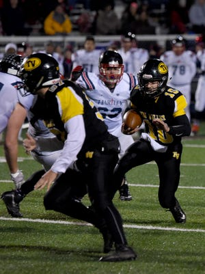 Tri-Valley's Andrew Newsom carries the ball in last week's win over Columbus Hartley. Newsom and the Scotties face off with Akron St. Vincent-St. Mary in a Division III semifinal on Friday.